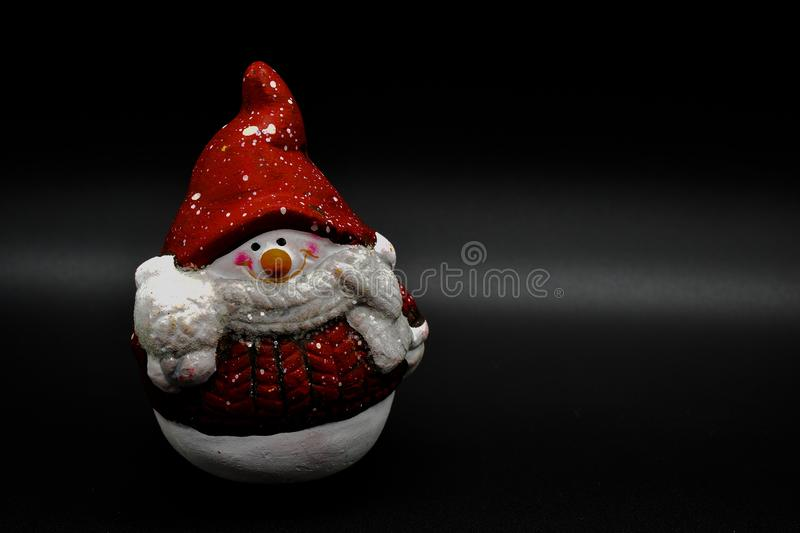 Handmade snowman figurine isolated on black background. Christmas decoration. stock image