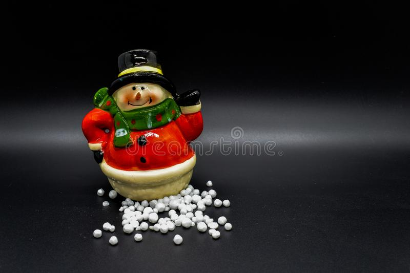 Handmade snowman figurine isolated on black background. Christmas decoration. stock images
