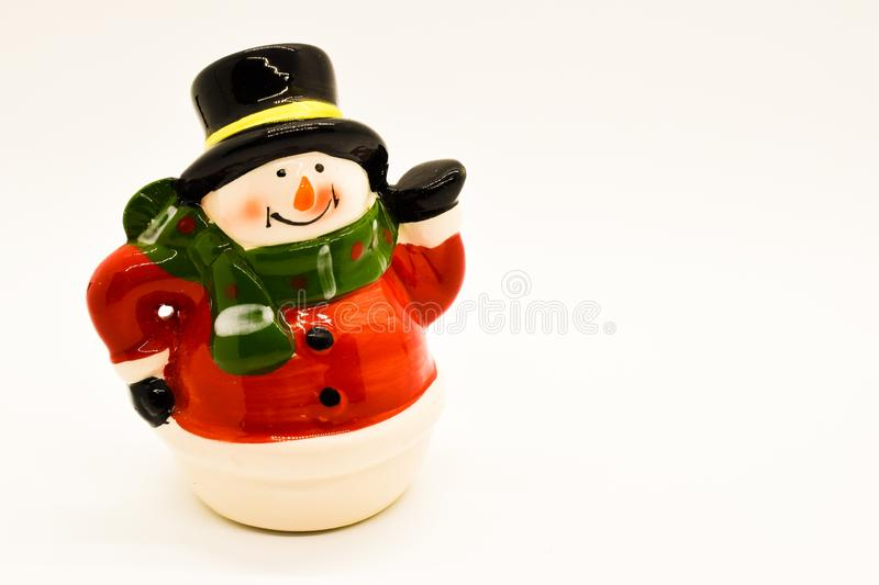 Handmade snowman figurine isolated on white background. Christmas decoration. stock photography