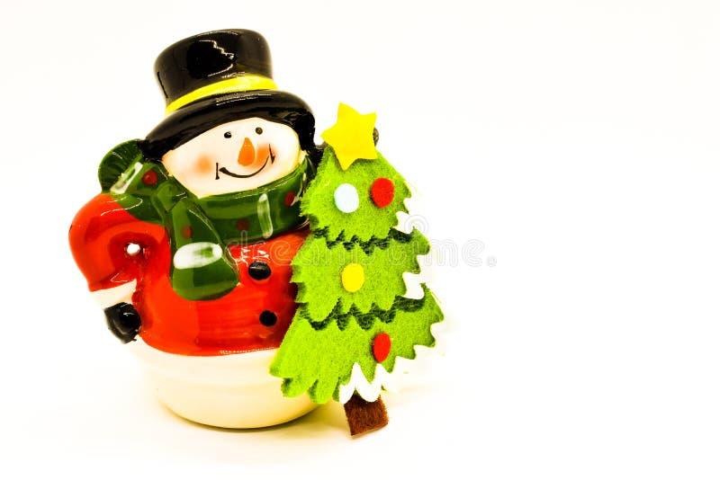 Handmade snowman figurine isolated on white background. Christmas decoration. stock photos
