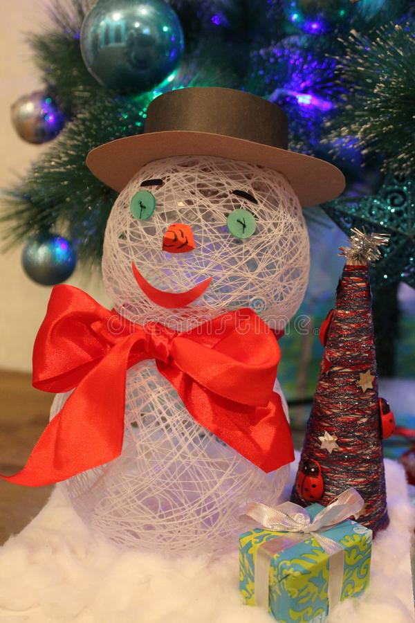 Handmade snowman gift and Christmas tree royalty free stock photography