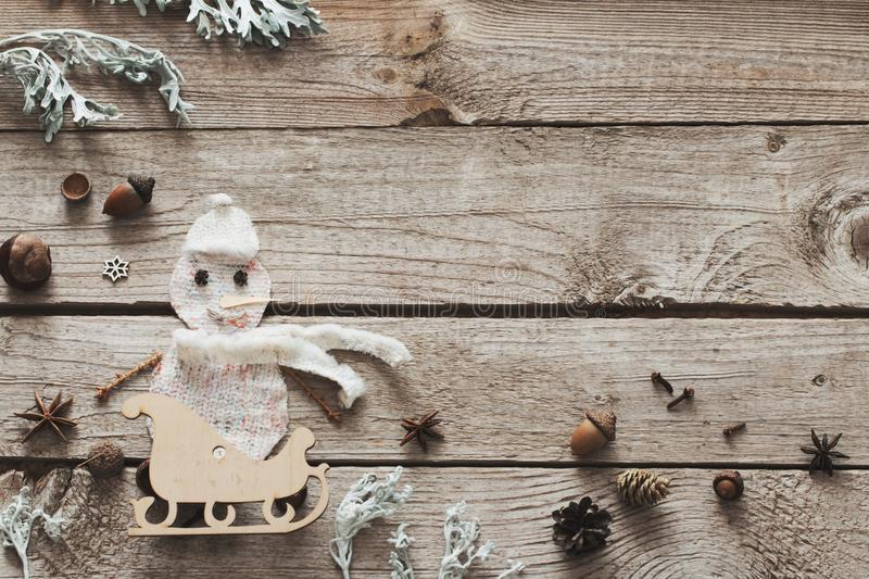 Handmade snowman on old wooden background royalty free stock photos