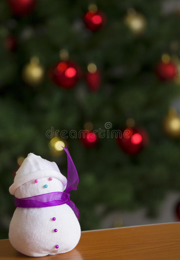 Handmade snowman. Sock snowman with purple scarf representing winter days royalty free stock photos