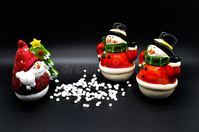 Handmade snowmen figurines isolated on black background. Christmas decoration. royalty free stock photography