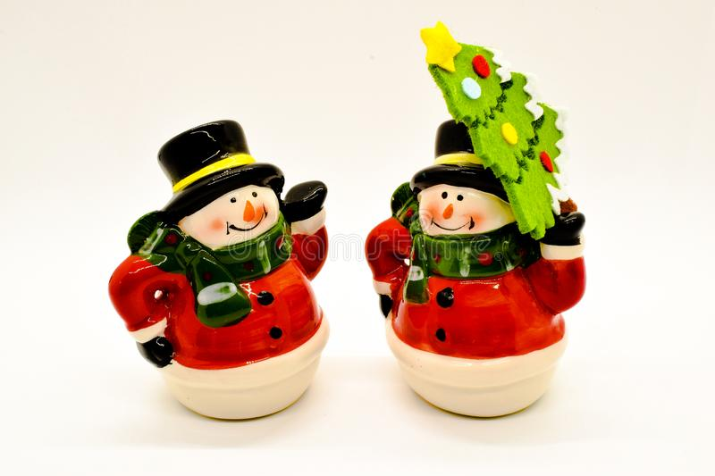 Handmade snowmen figurines isolated on white background. Christmas decoration. stock images