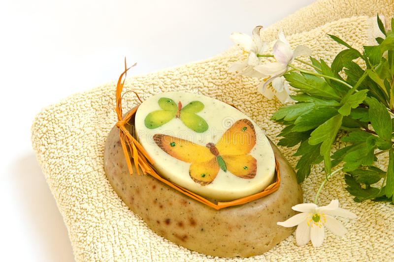 Handmade soap. Lying on a towel with flowers stock images