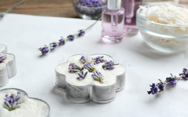 Handmade soap bar with lavender flowers in metal form on white paper royalty free stock photography