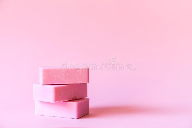 Soap bars on soft pink background. Handmade soap bars on soft pink background royalty free stock photos