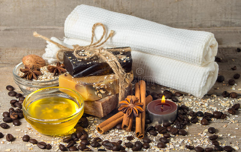 Handmade soap with coffee beans and spices on a wooden backgroun stock photography
