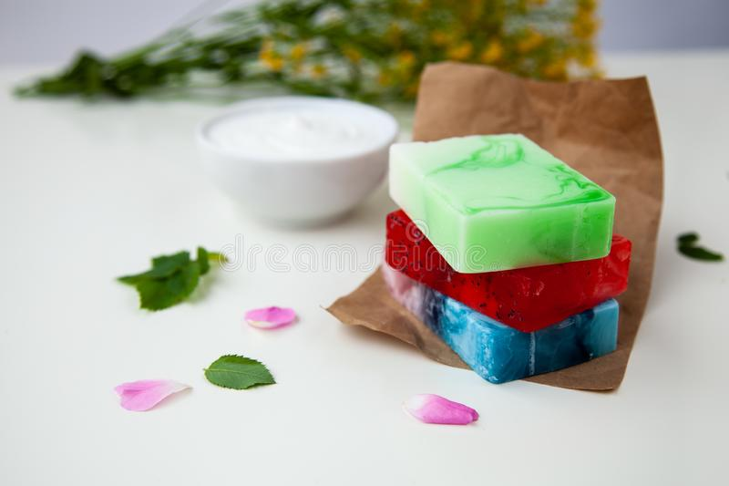 Handmade soap on the craft paper. With flowers and cream royalty free stock photography