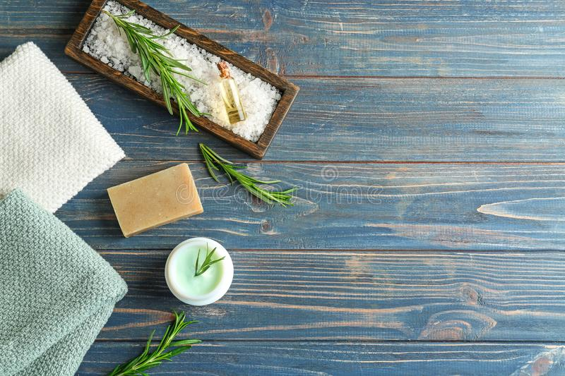 Handmade soap and cream with rosemary on wooden table royalty free stock images