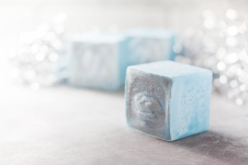 Handmade soap in the form of snowflakes, natural cosmetics concept. Place for text. Selective focus stock photos