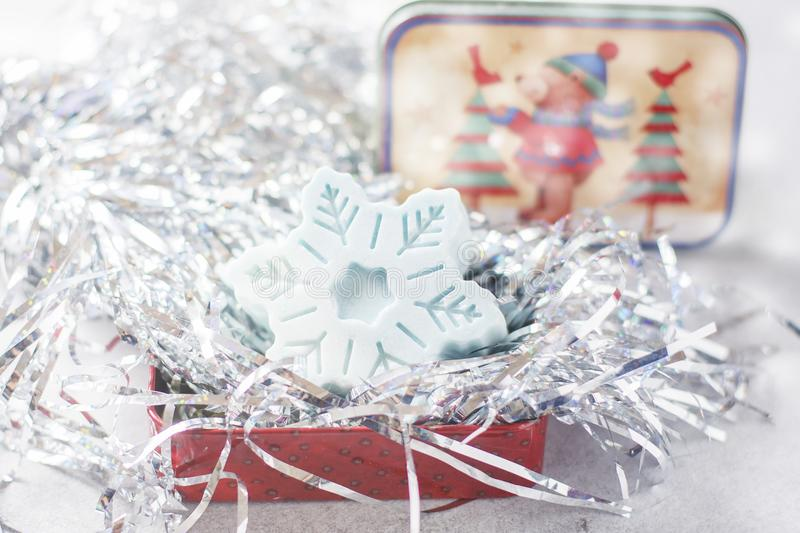 Handmade soap in the form of snowflakes, natural cosmetics concept. Place for text. Selective focus stock images