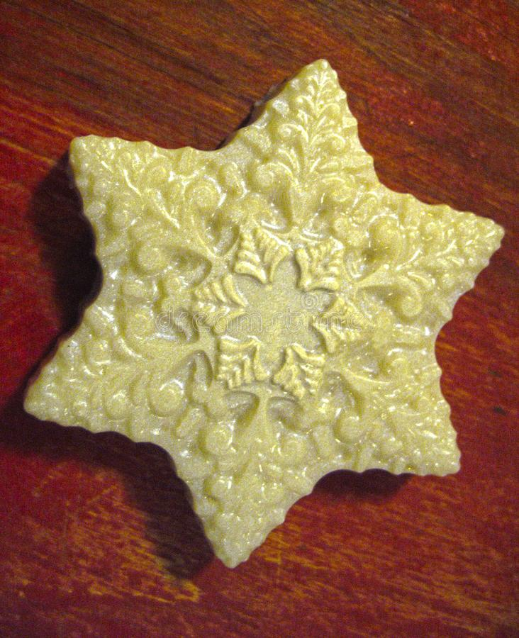 Handmade soap in the form of a white snowflake stock images