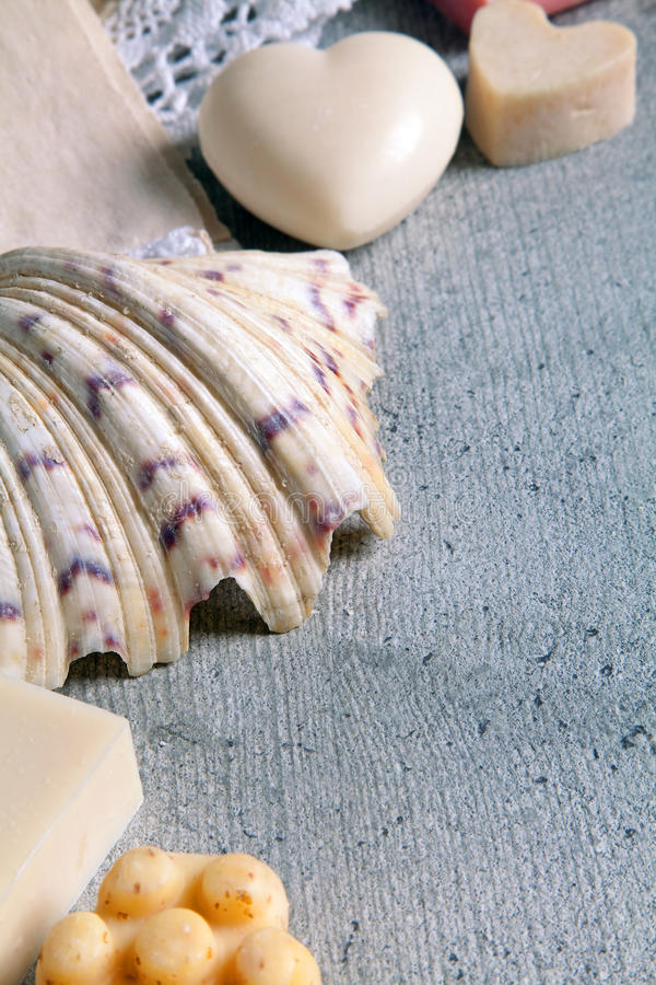 Handmade soaps and shell. Handmade soaps, towel with lace, shell stock image
