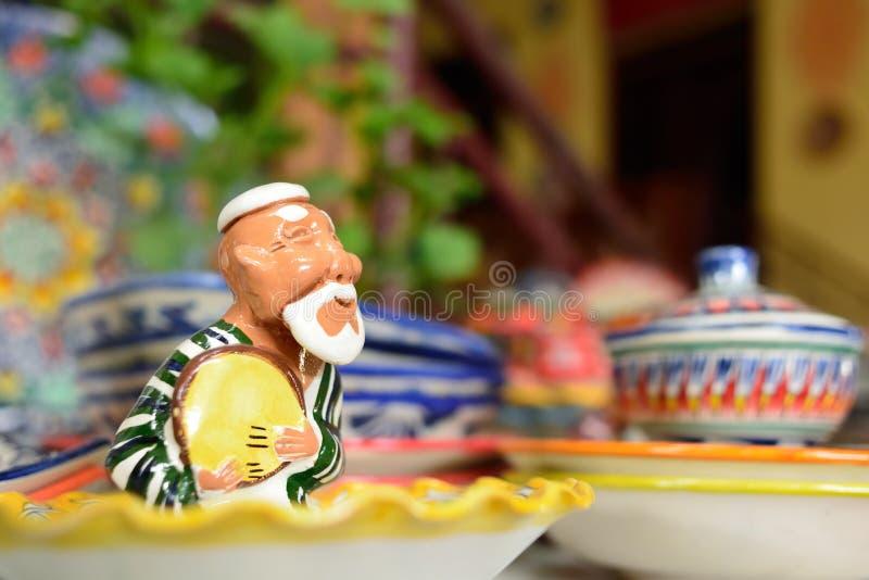 Handmade souvenirs from Central Asia, Fergana, Uzbekistan, Silk Route. Handmade colourful ceramic pottery  selling at street stall in Rishton, Uzbekistan, silk royalty free stock image