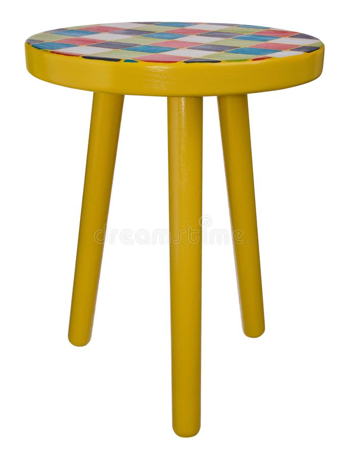 Handmade stool wooden yellow. Round seat wooden, painted in multicolored squares. stock images