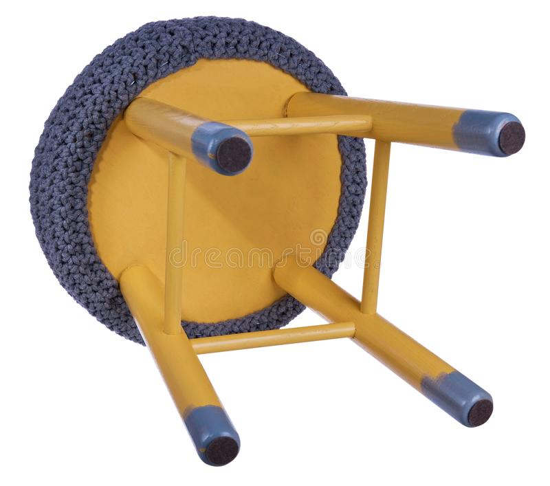 Handmade stool yellow and gray. Round seat in grey, woolen mater royalty free stock photography