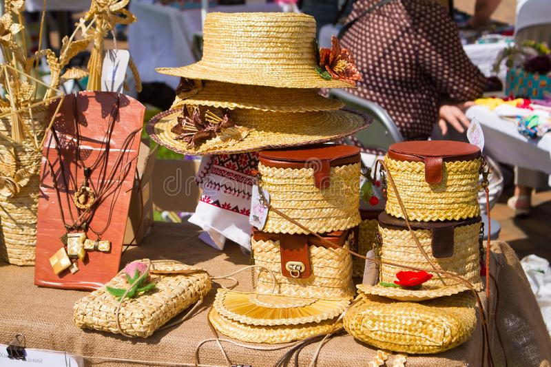 Handmade straw plaited hats and small ladies` handbags embroidered with ornaments, ancient fashion folklore items royalty free stock images