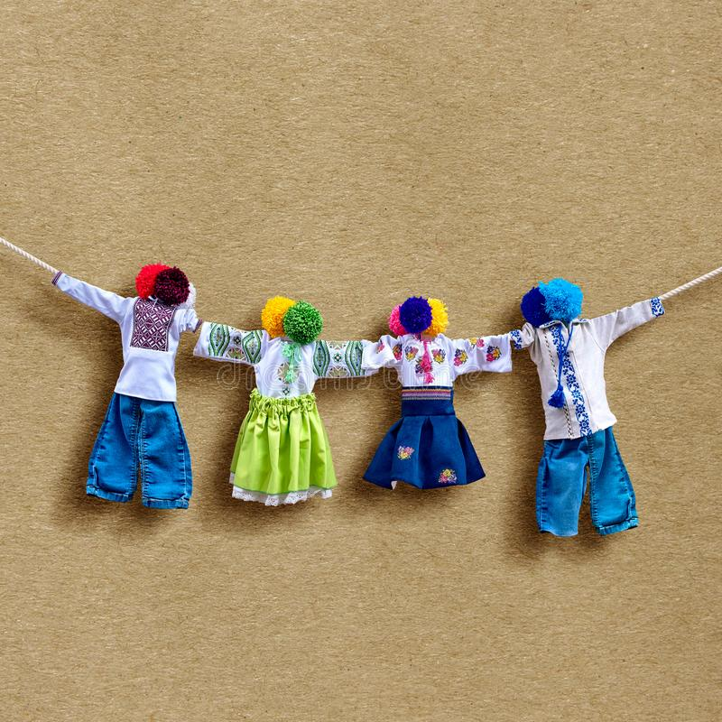 Handmade textile dolls on background, traditional ukrainian folk rag doll Motanka in ethnic style, ancient culture folk stock photography