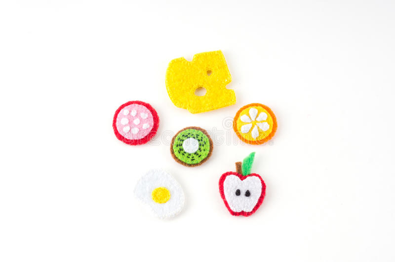 Handmade toy in the form of fruits and food made of felt . Close stock photography