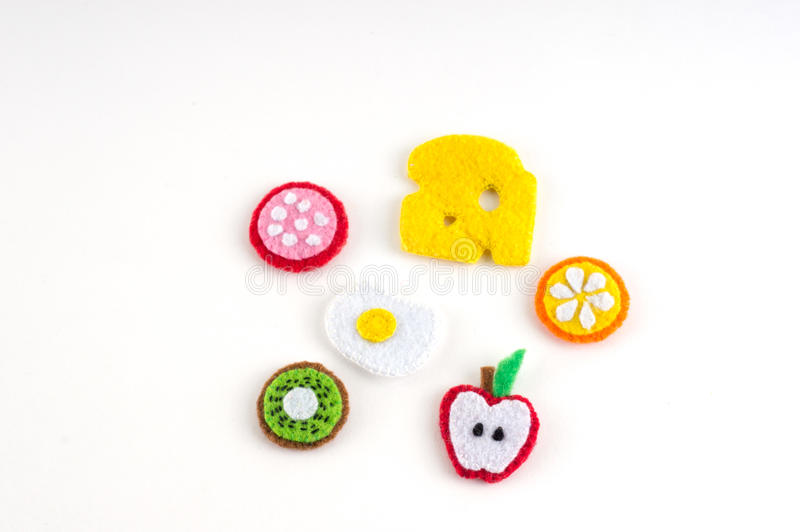 Handmade toy in the form of fruits and food made of felt . Close royalty free stock image