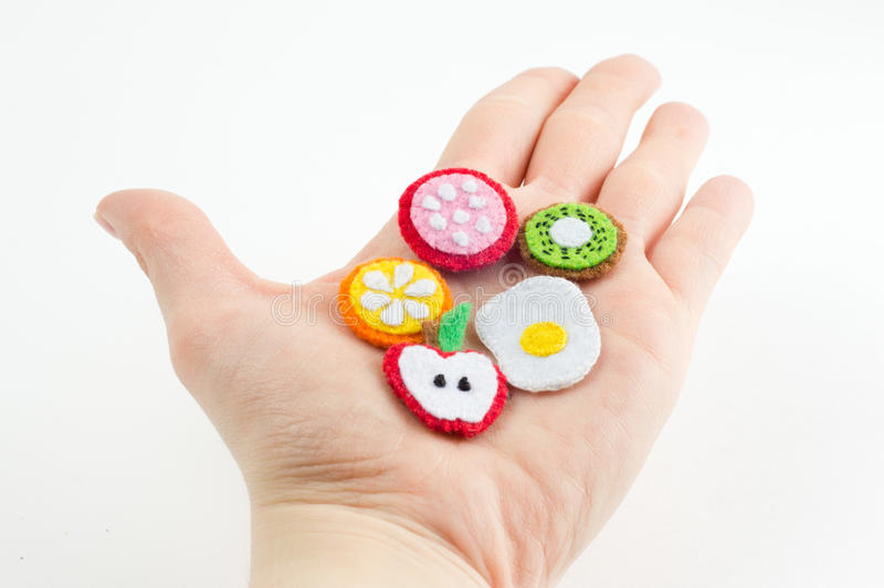 Handmade toy in the form of fruits and food made of felt stretch stock image