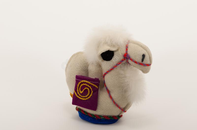 A handmade camel toy. stock images