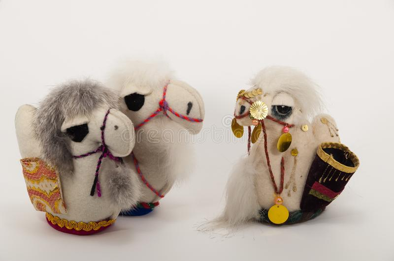 A handmade three small camel toy. royalty free stock photography