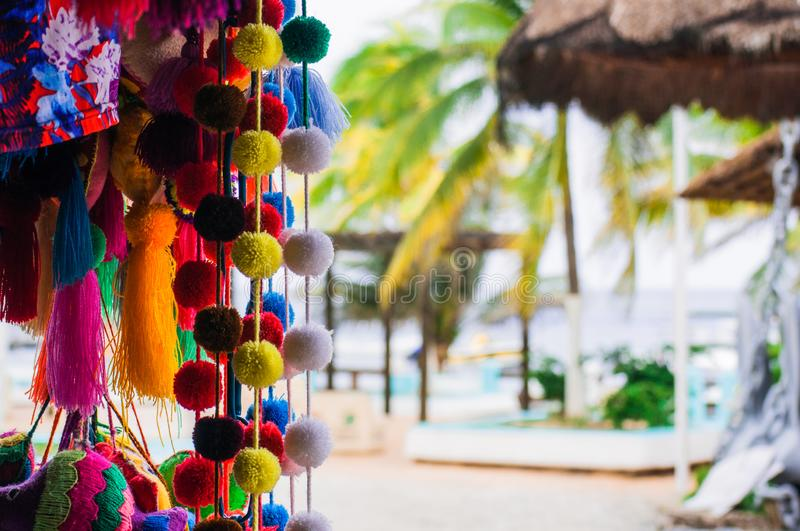 Handmade traditional Mexican souvenirs at the gift market. In Puerto Morelos, Mexico, close up royalty free stock photos