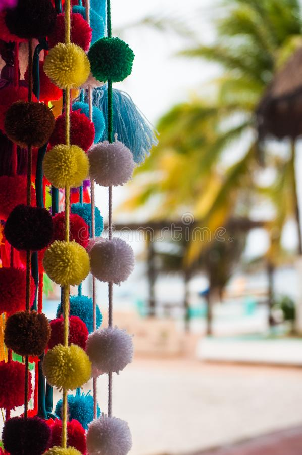 Handmade traditional Mexican souvenirs at the gift market. In Puerto Morelos, Mexico, close up stock image
