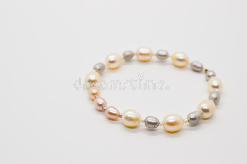 Handmade unique pearls bracelet on a white background. Rose pearl grey pearl jewelry accessory wrist handmade craft crafting gift fashion lady women shell stock images