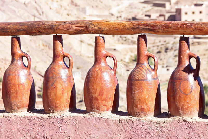Handmade vases from clay cemented in a wall