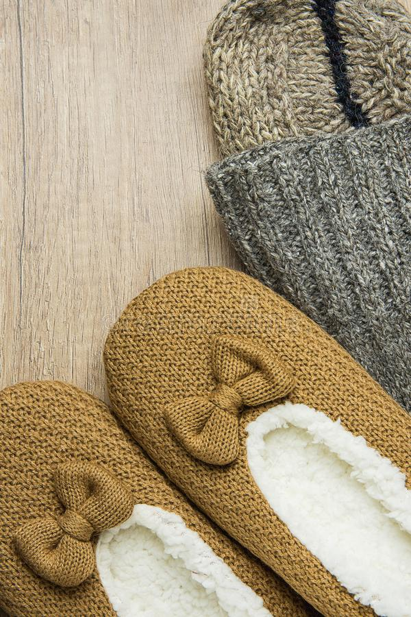Handmade Warm Knitted Socks From Coarse Wool Yarn Fluffy Fur Slippers on Wood Background. Winter Autumn Eco Fashion Cloths Kinfolk. Style. Natural Materials stock photos