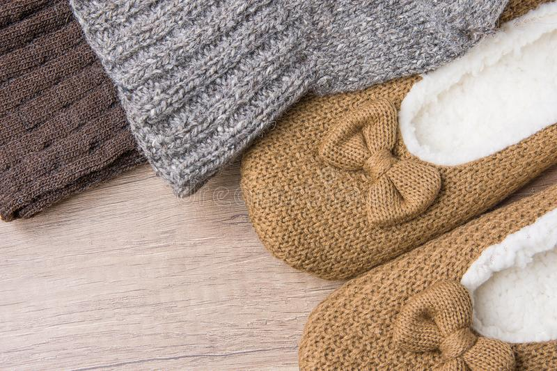 Handmade Warm Knitted Socks From Coarse Wool Yarn Fluffy Fur Slippers on Wood Background. Winter Autumn Eco Fashion. Kinfolk Style. Natural Materials stock image