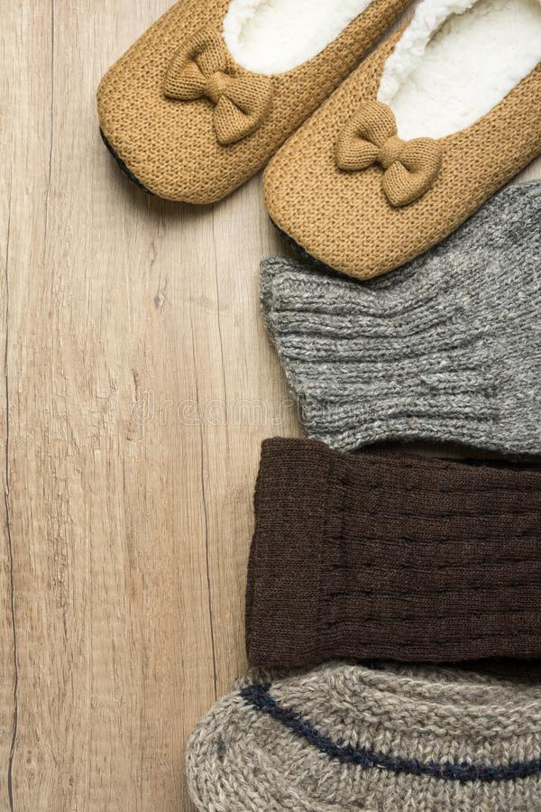 Handmade Warm Knitted Socks From Rough Wool Yarn Fluffy Fir Slippers on Wood Background. Winter Autumn Eco Fashion. Kinfolk Style. Natural Materials royalty free stock photo