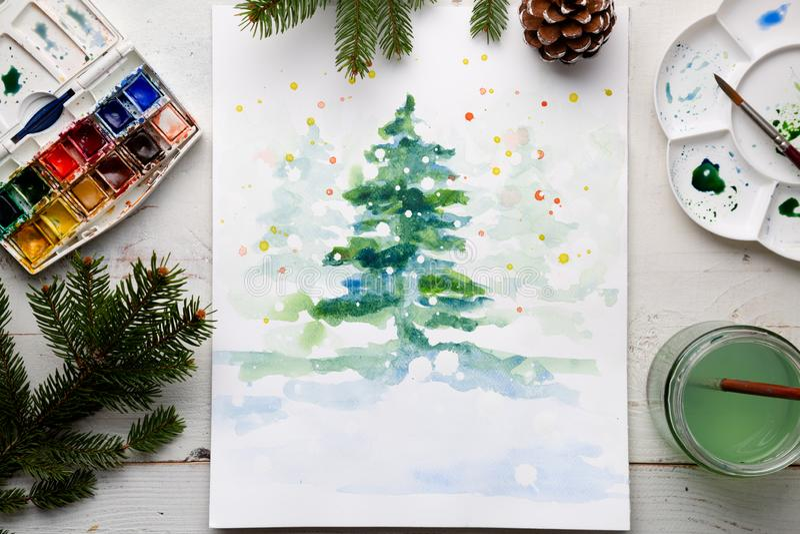 Handmade watercolor Christmas card on the work table stock photo