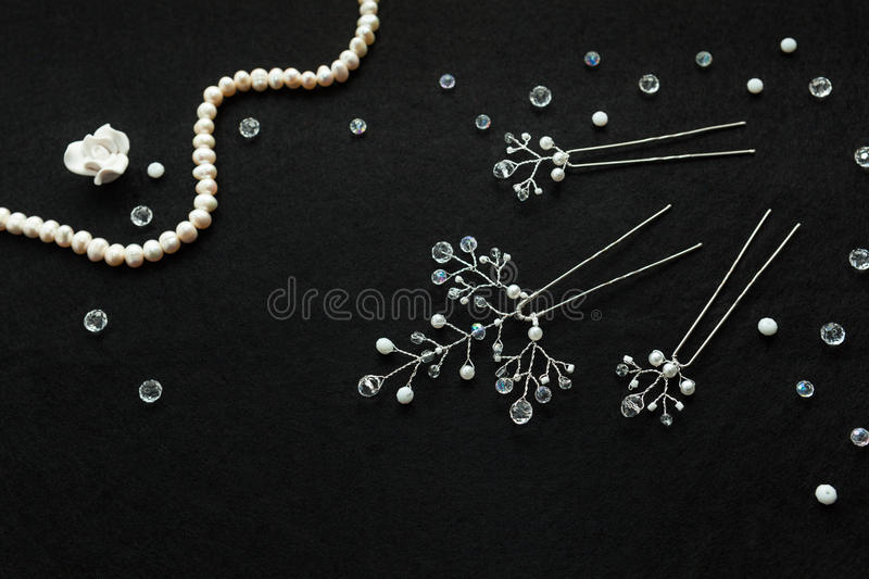 Handmade wedding jewelry and pearls on the the black background royalty free stock image