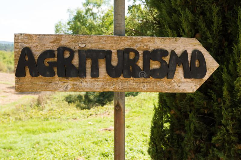 Handmade wooden agriturismo sign. In Tuscany - agritourism is a typical concept of bed and breakfast in a farming environment in Italy stock image