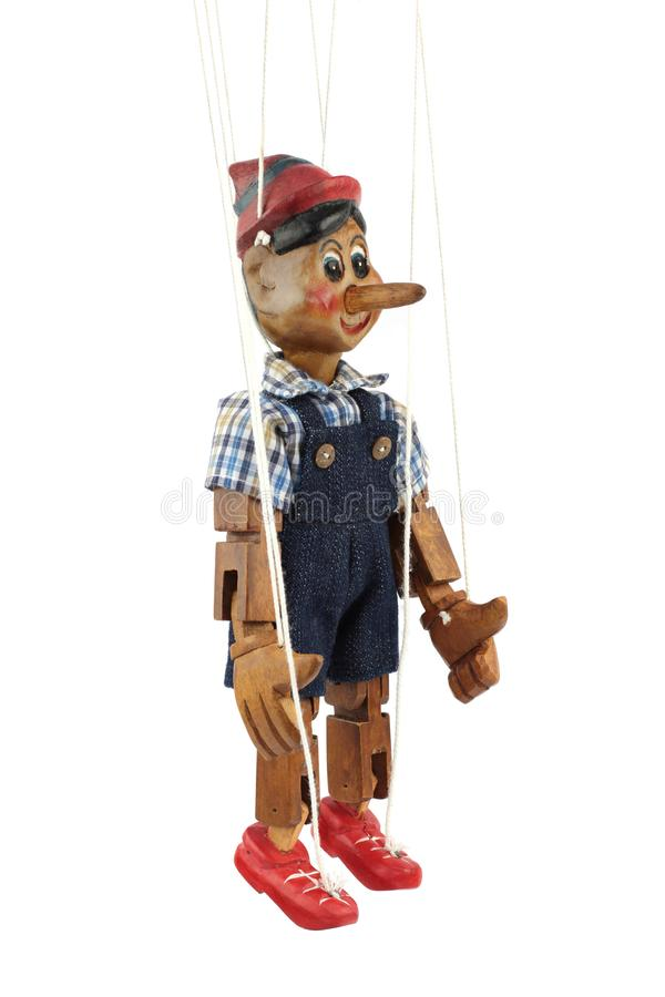 Handmade wooden puppet Pinocchio. Handmade wooden puppet Pinocchio on white background royalty free stock images