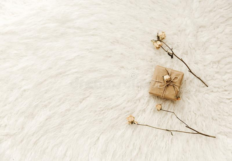 Handmade wrapped gifts with dry flower. Minimal cozy royalty free stock images