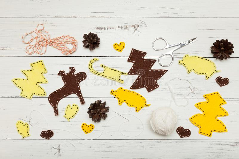 Handmade yellow Christmas craft composition. Kids creative decorations.  stock images