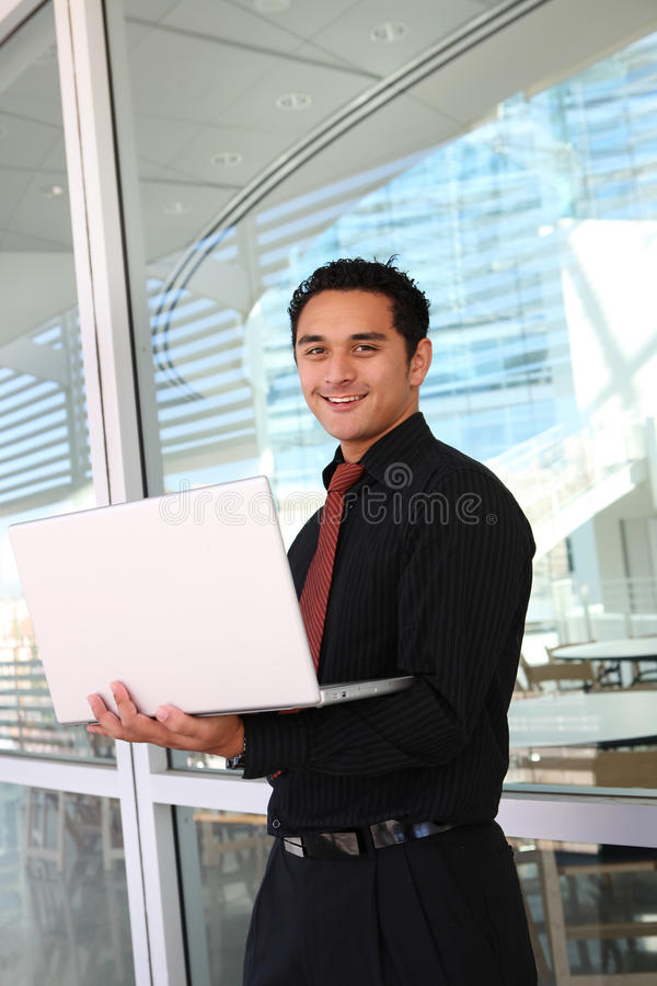Handome Hispanic Business Man. At office with laptop computer royalty free stock photography