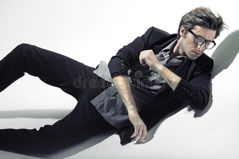 Handosme model wearing fashion clothes royalty free stock images