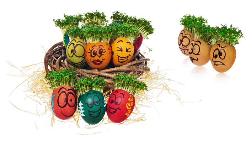 Handpainted Easter eggs in funny scared and surprised cartoonish faces with cress like hair look at the outstanding foreign stock images