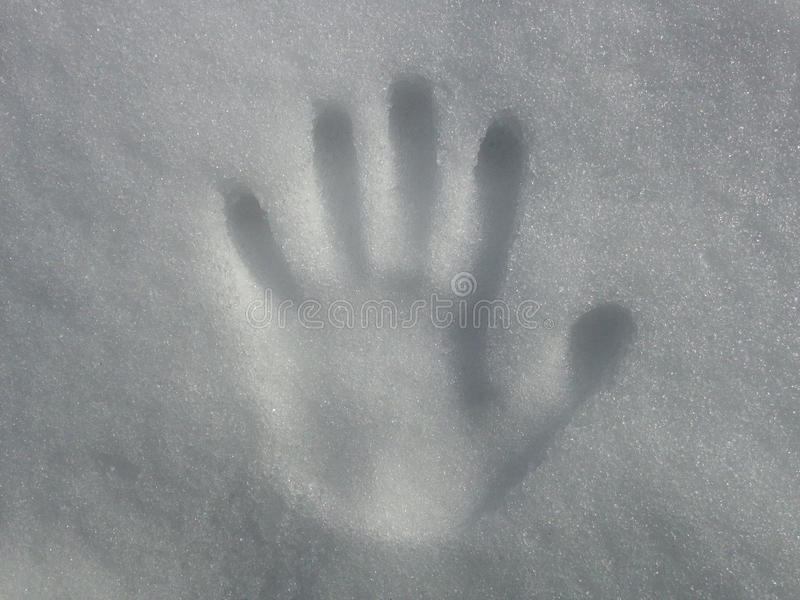 Handprint op Sneeuw stock afbeeldingen