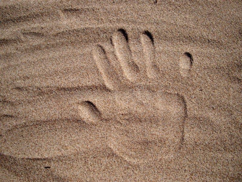Handprint in sand royalty free stock photo