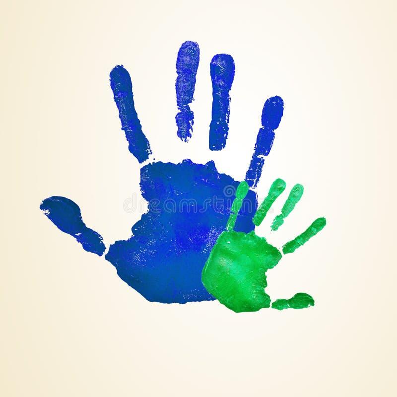 Handprints adultes et infantiles photos stock