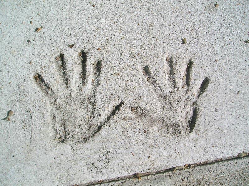 Handprints in cemento immagine stock