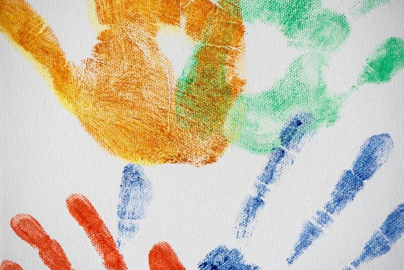 Handprints colorido de vários tamanhos na lona fotografia de stock royalty free